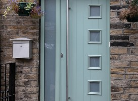 Milano composite door in Chartwell Green with ES3 door handle and integrated side panel.