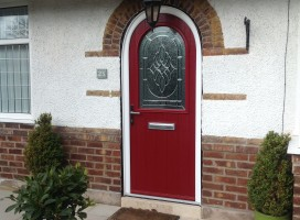 Bespoke shaped composite door in Red with Elegance glass.