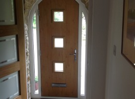 Bespoke composite door with integrated side lights in Irish Oak interior installed in Holmfirth.