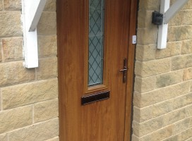 Flint 4 composite door in Golden Oak with brilliante glass, Huddersfield