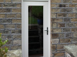 Windsor composite door in White with glazing cassette and top light.