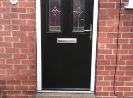 Black arched Conway 3 composite door with Royale glass installed in house in Lincoln