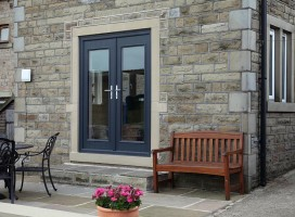 We created the door opening then installed these French composite doors