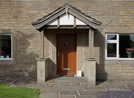 Bologna composite door in Golden Oak with clear glass.