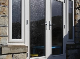 Biella composite French doors with integrated side panels.