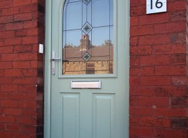 Stafford composite door in Chartwell Green with Quad Sea Green glass.