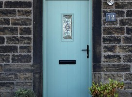 Ancona composite door in Chartwell Green with Royale glass.