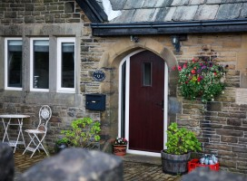 Bespoke Flint 2 composite door with shaped top in Rosewood, Linthwaite