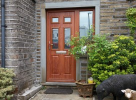 Tenby 4 composite door in Golden Oak with integrated side panel, Hade Edge