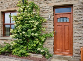 London composite door in Golden Oak with Caledonia rose glass