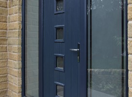 Bespoke composite door in Grey with integrated top light and side panels.