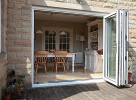 Aluminium bi-fold doors in White