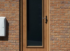 Biella composite door in Irish Oak with satin glass