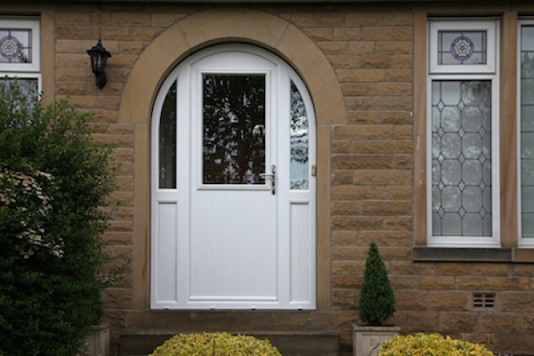White arched Beeston composite door with integrated side panels.