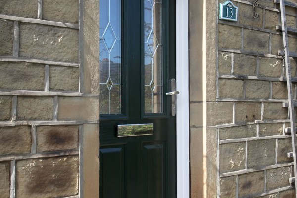 Nottingham 2 composite door in Green with bespoke glass.
