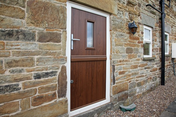 Bespoke Flint 2 composite stable door in Walnut with Cream frame installed at converted barn in Sheffield.